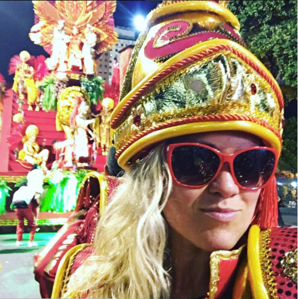 Parading in the official Rio Carnival in costume.